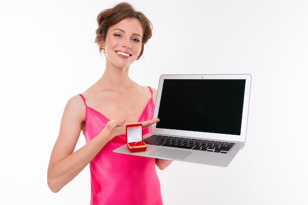 Jewelry seller with ring and laptop screen forward