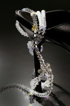 Jewels around a fashion black shoe heel