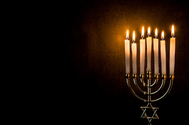 Jewish hanukkah menorah on black copy space