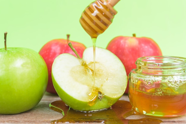 Jewish holiday apple rosh hashanah the photo have honey in jar and drop honey on green apples