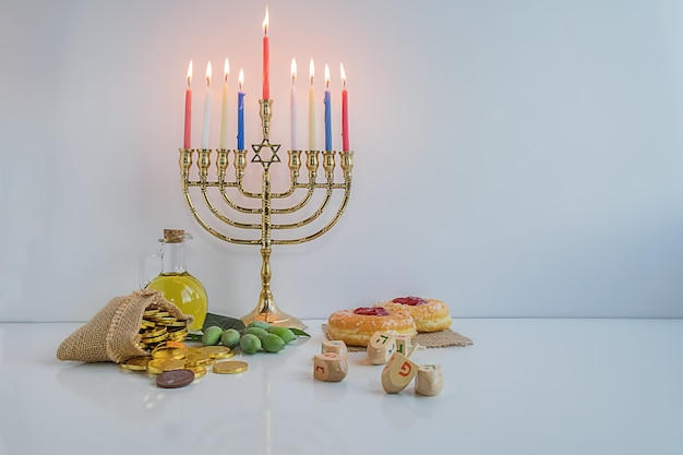 Jewish holiday hanukah celebration with menorah