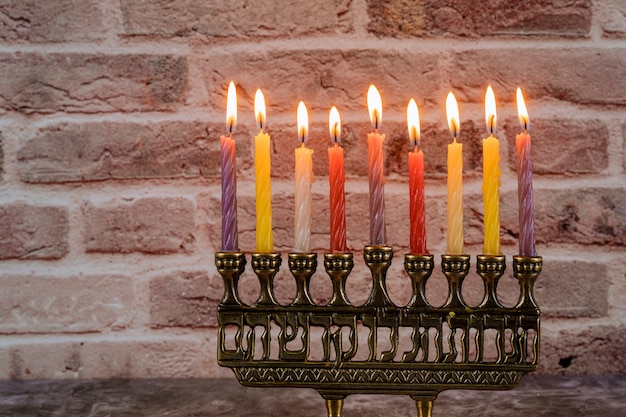 Jewish holiday hanukkah with menorah traditional candelabra and burning candles