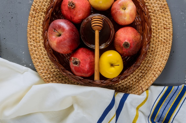 Jewish holiday honey and apples with pomegranate torah book
