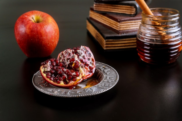 Jewish holiday honey and apples with pomegranate
