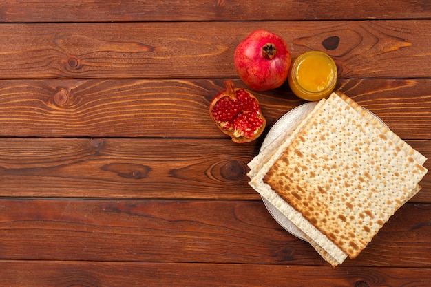 Jewish holiday passover banner design with wine, matzo on wooden .