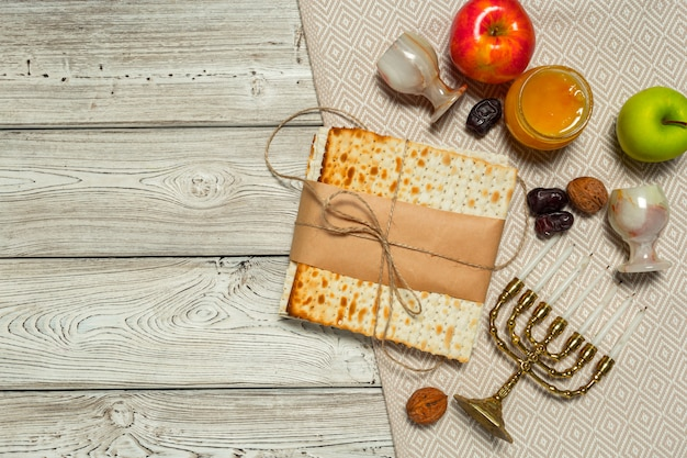 Jewish holiday passover banner design with wine, matzo on wooden ,