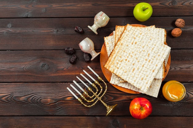 Jewish holiday passover table with wine, matzo on wood