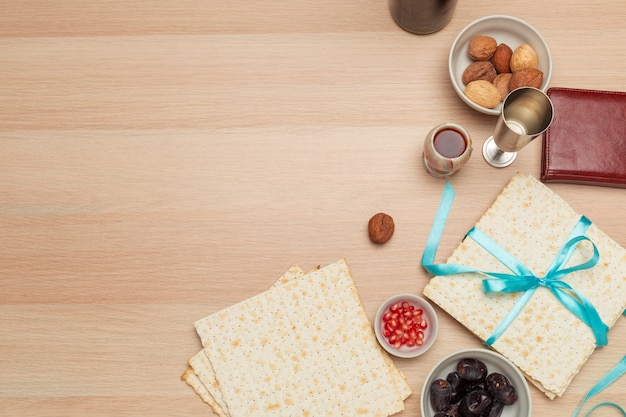 Jewish holiday passover with wine, matzo on wooden background