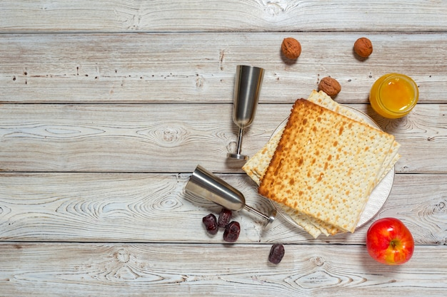 Jewish holiday passover with wine, matzo on wooden.