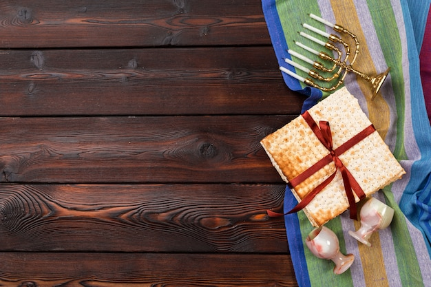 Jewish holiday passover with wine, matzo on wooden.