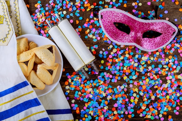 Jewish holiday purim with carnival mask and hamantaschen cookies. flat lay