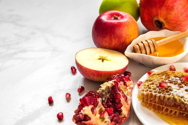 Jewish holiday rosh hashana background with honey, pomegranate and apples