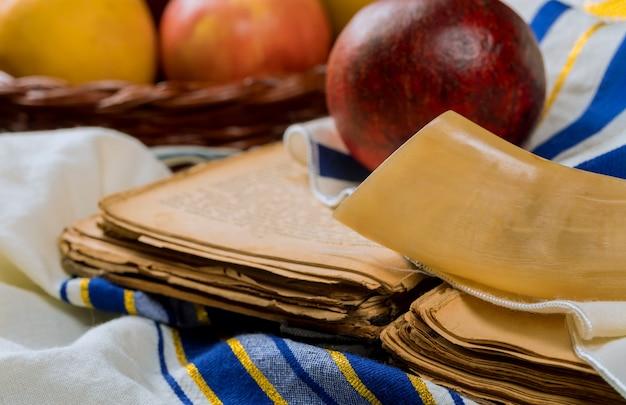 Jewish holiday rosh hashanah, apples honey and pomegranate torah book, kippah a yamolka talit