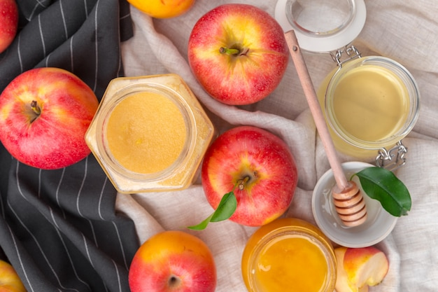 Jewish holiday rosh hashanah  with honey and apples on wooden table.