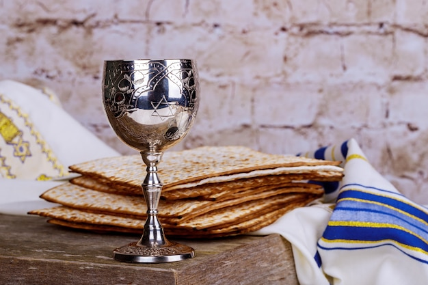 Jewish holidays passover pesach matzah and a silver cup full of wine