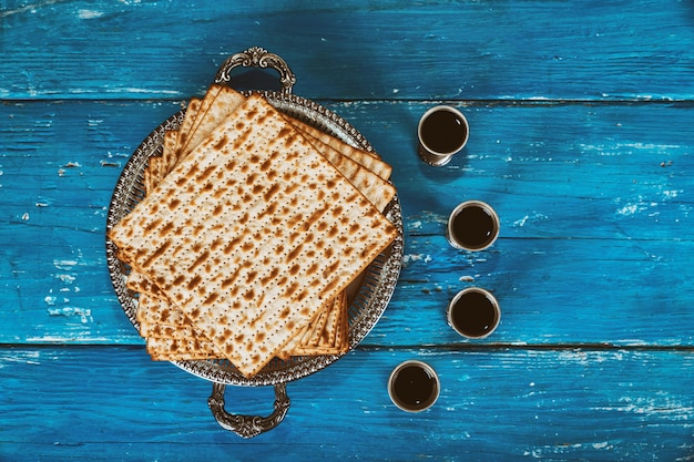 A jewish matzah bread with four glasses wine. passover holiday concept