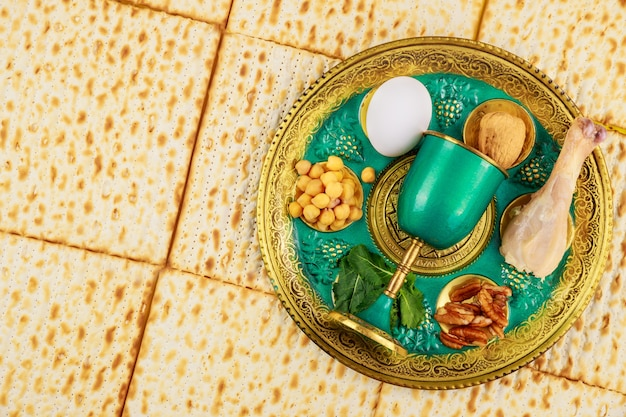 Jewish matzah, kiddush and seder with egg, bone, herbs and walnuts. passover holiday concept.