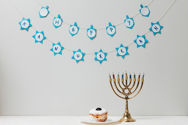 Jewish menorah and a donut on a table