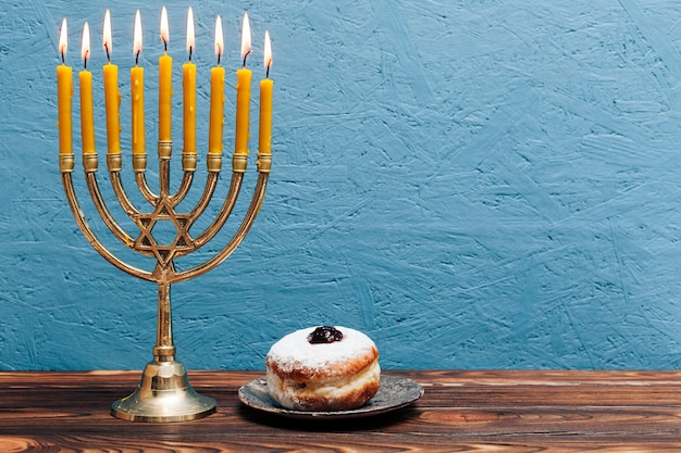 Jewish menorah with tasty donut