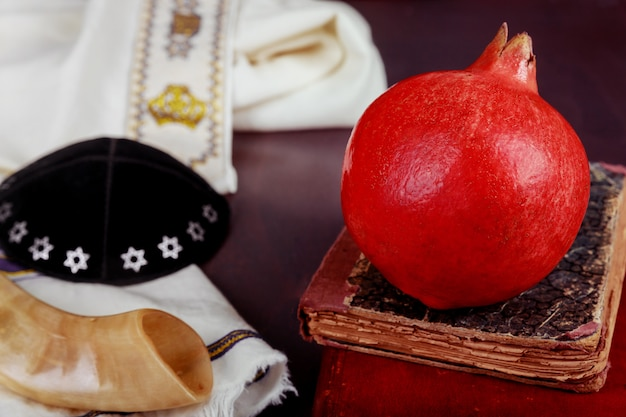 Jewish new year rosh hashana traditional food and torah book, kippah yamolka talit
