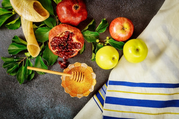 Jewish prayer talit with traditional food and horn for rosh hashanah.