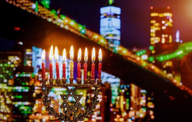 Jewish symbol jewish holiday hanukkah with menorah brooklyn bridg, new york city