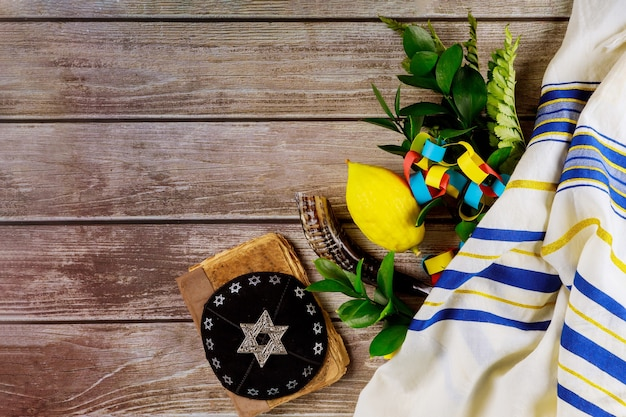 Jewish symbols holiday of sukkot in kippah tallit a synagogue