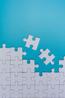 Jigsaw puzzle on blue background