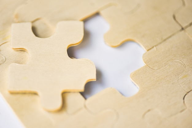 Jigsaw puzzle - close up of jigsaw pieces for joining and trying to connect business partnership concept