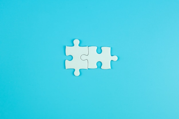Jigsaw puzzle pieces frequently with copy space for text. solutions, mission, successful, goals, cooperation, partnership and strategy concept