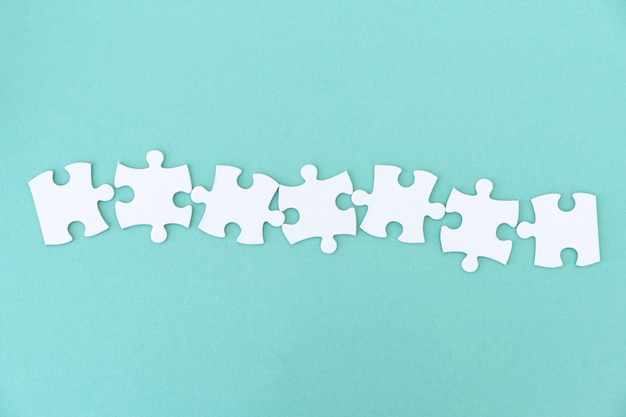 Jigsaw puzzle pieces in row