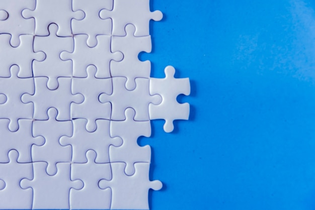 Jigsaw with one piece missing revealing