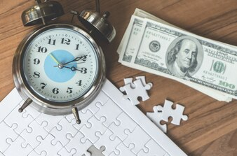 Jigsaws last step with time counting down for financial solution concept
