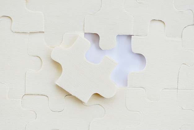 Jigsaws puzzles on white jigsaw pieces on texture