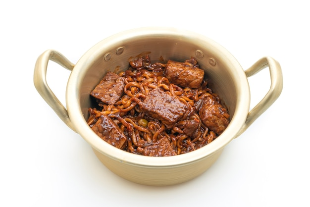 Jjapaguri or chapaguri, korean black beans spicy noodles with beef isolated on white background