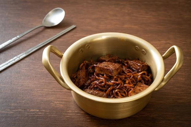 Jjapaguri or chapaguri, korean black beans spicy noodles with beef - korean food style
