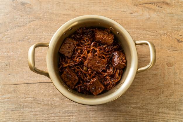 Jjapaguri or chapaguri, korean black beans spicy noodles with beef