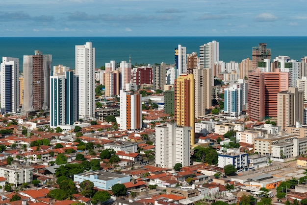 Joao pessoa paraiba brazil on may 17 2011 showing buildings and the sea in the background