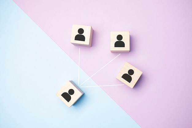 Job interview concept - abstract people on wooden cubes. close up.