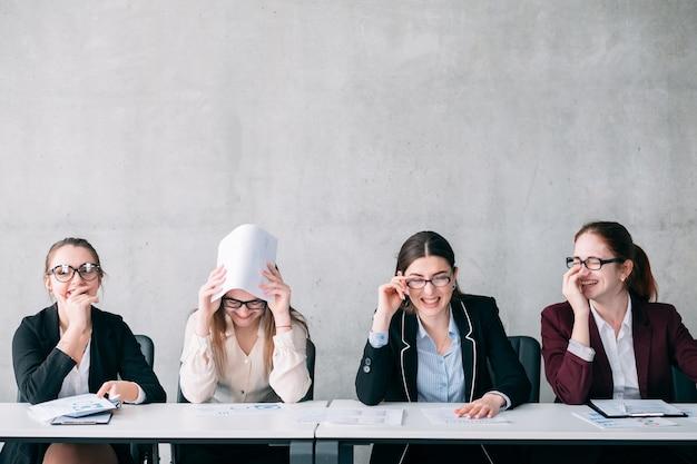 Job interview failure. corporate recruitment. hr females laughing at virtual job applicant.