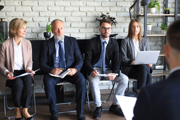 Job interview with the employer, business team listen to candidate answers.