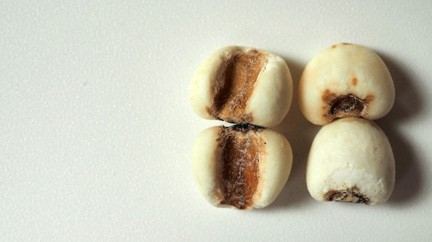 Job's tears, also known as adlay and coix on calico background. popular in asian cultures as a food source.