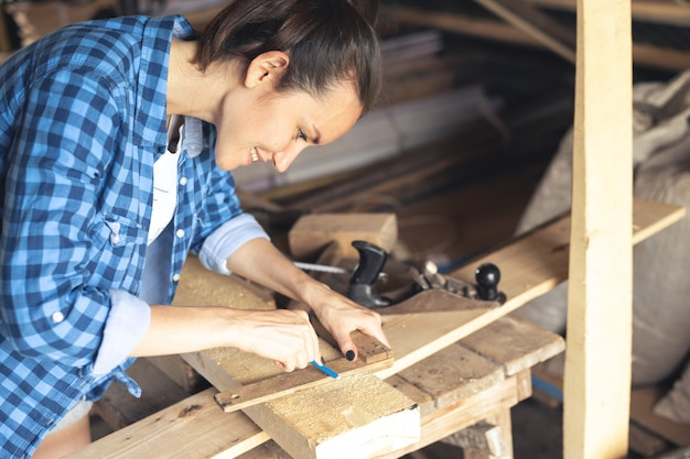 Joiner is engaged in work in a home workshop