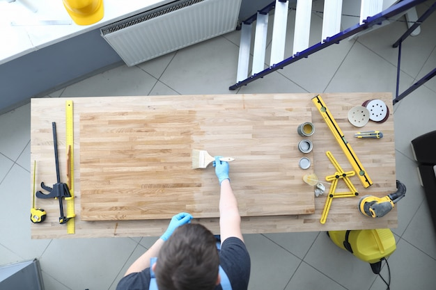 Joiner polishes a wooden surface