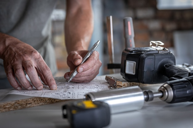 Joiner in the process of work, measurements, drilling accuracy.