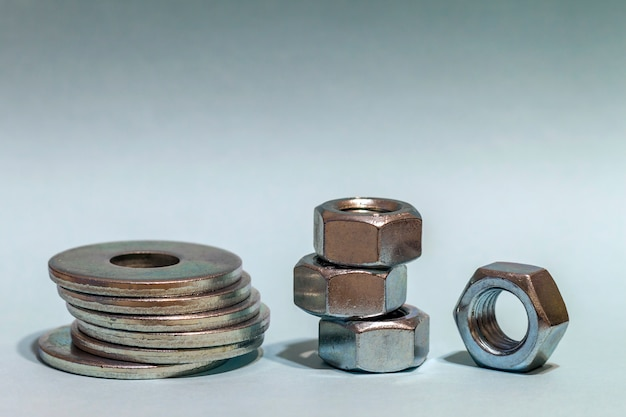 Joiner's accessories. stacks of metal screw washers and nuts iso