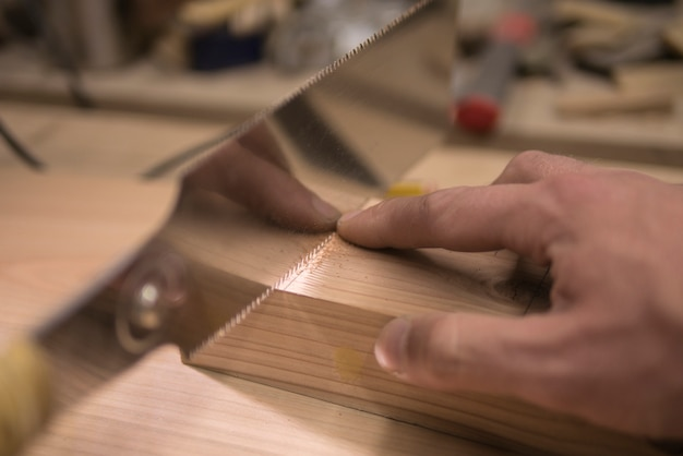 Joiner sawing with a saw