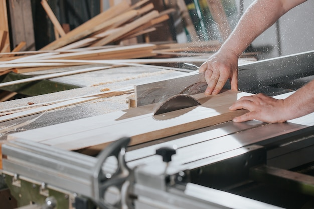 Joinery and wood work concept  professional joiner  carpenter making  sawing furniture  handcraft  manufacture work