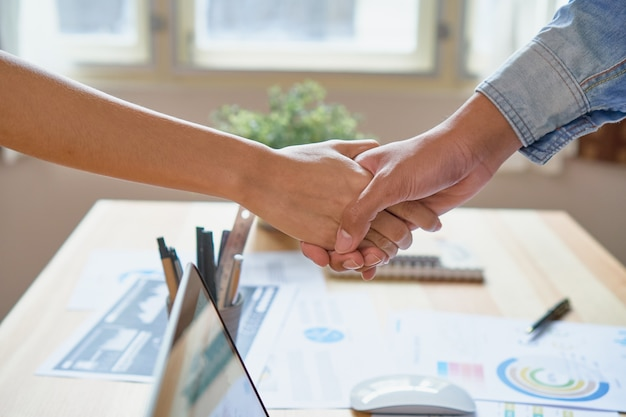 Joint hands of two businessmen after negotiating a successful business agreement.