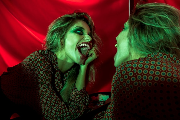 Joker woman laughing in the mirror